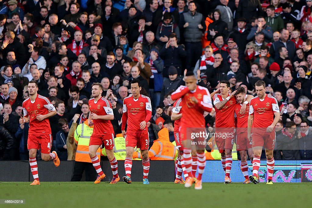 Adam Lallana (2nd R) of Southampton celebrates with team-mates after scoring the opening goal during the Barclays Premier League match between Fulham and Southampton at Craven Cottage on February 1, 2014 in London, England.