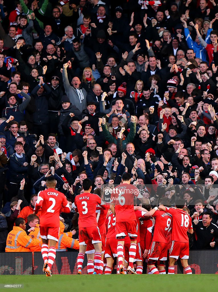 Adam Lallana (hidden) of Southampton celebrates with team-mates in front of the fans after scoring the opening goal during the Barclays Premier League match between Fulham and Southampton at Craven Cottage on February 1, 2014 in London, England.