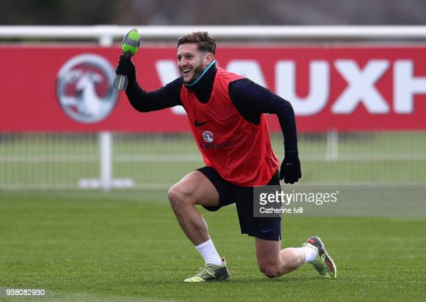 Adam Lallana performs a drill during an England training session on the eve of their international friendly against Italy at Tottenham Hotspur...