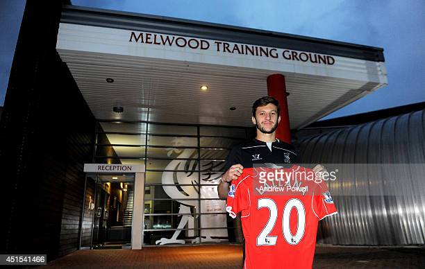 Adam Lallana poses as he is unveiled as a new signing for Liverpool Football Club at Melwood training gound on June 30 2014 in Liverpool England
