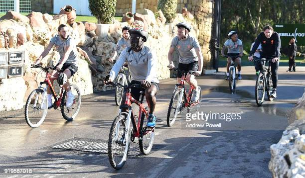Adam Lallana Sadio Mane Danny Ings and James Milner of Liverpool arrive on a bike before a training session at Marbella Football Center on February...