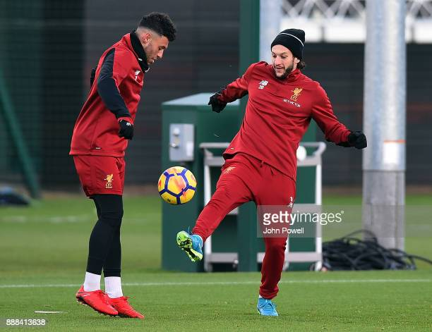 Adam Lallana with Alex OxladeChamberlain of Liverpool during a training session at Melwood Training Ground on December 8 2017 in Liverpool England