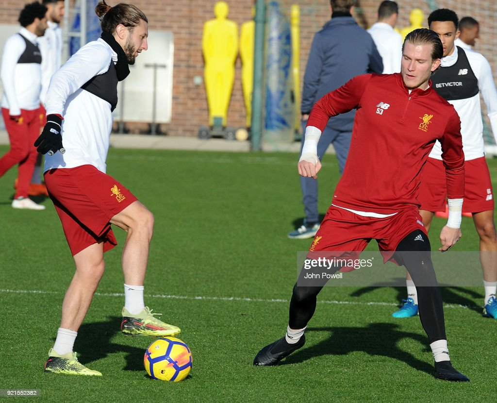Adam Lallana with Loris Karius of Liverpool during a training session at Melwood Training Ground on February 20, 2018 in Liverpool, England.