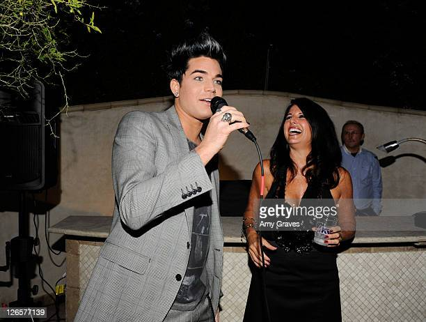 Adam Lambert addresses the crowd as Leila Lambert looks on at the 2011 PFLAG National LA Event on September 25 2011 in Beverly Hills California