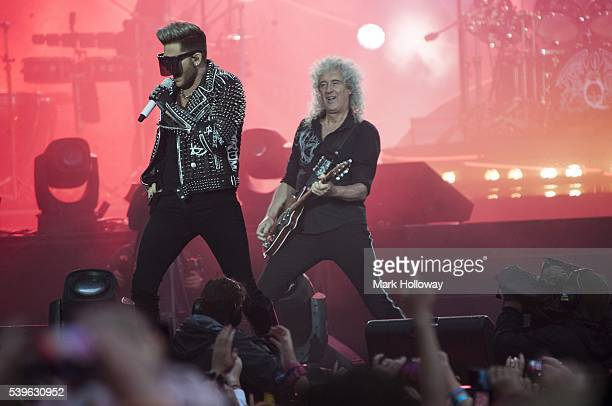 Adam Lambert and Brian May of Queen + Adam Lambert perform on stage at Seaclose Park on June 12, 2016 in Newport, Isle of Wight.