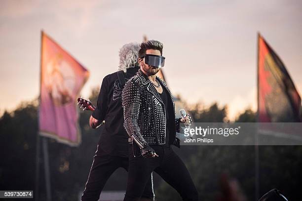 Adam Lambert and Brian May of Queen + Adam Lambert perform on stage at the Isle Of Wight Festival 2016 at Seaclose Park on June 12, 2016 in Newport,...