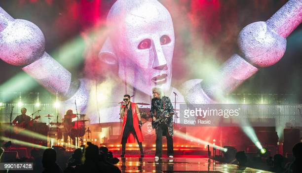 Adam Lambert and Brian May of Queen and Adam Lambert perform live on stage at The O2 Arena on July 2 2018 in London England