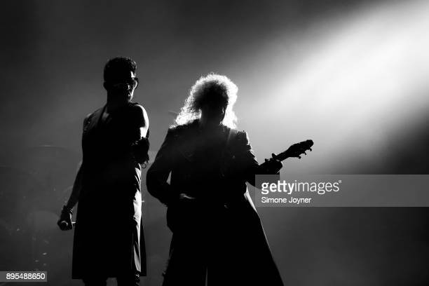 Adam Lambert and Brian May of Queen perform live on stage at The O2 Arena on December 12 2017 in London England