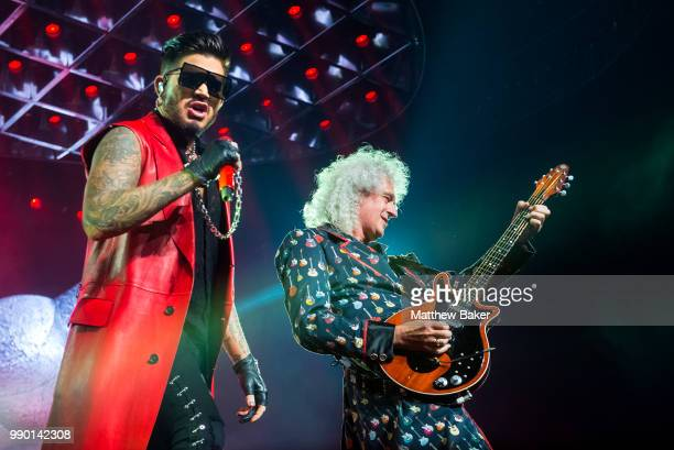 Adam Lambert and Brian May of Queen perform live on stage at The O2 Arena on July 2 2018 in London England