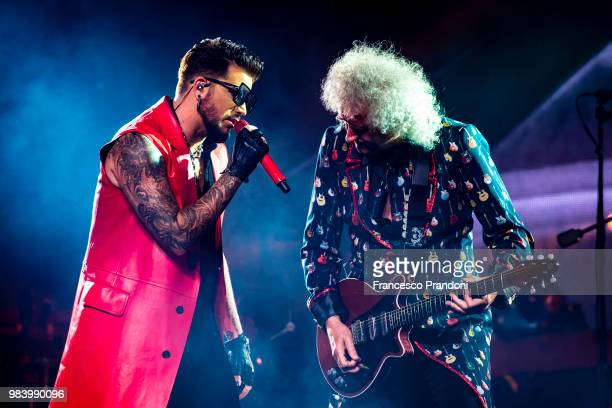 Adam Lambert and Brian May of Queen perform on stage at Mediolanum Forum on June 25 2018 in Milan Italy