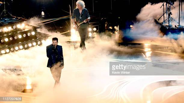 Retransmission with alternate crop Adam Lambert and Brian May of Queen perform onstage during the 91st Annual Academy Awards at Dolby Theatre on...