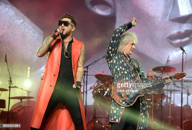 Adam Lambert and Brian May perform on stage with Queen at Wembley Arena on July 1 2018 in London England