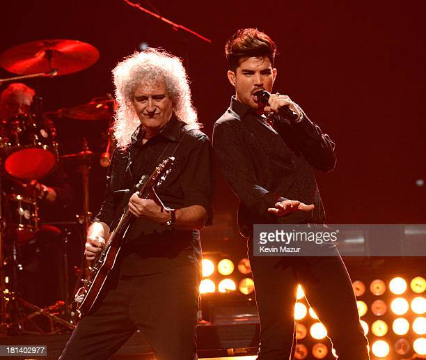 Adam Lambert and Brian May perform onstage during the iHeartRadio Music Festival at the MGM Grand Garden Arena on September 20 2013 in Las Vegas...