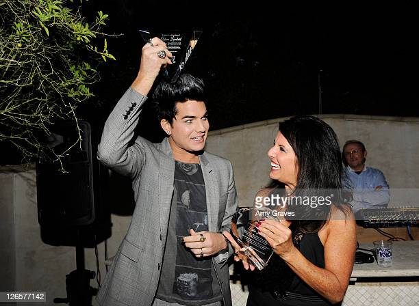 Adam Lambert and Leila Lambert pose for a photo with their awards at the the 2011 PFLAG National LA Event on September 25 2011 in Beverly Hills...
