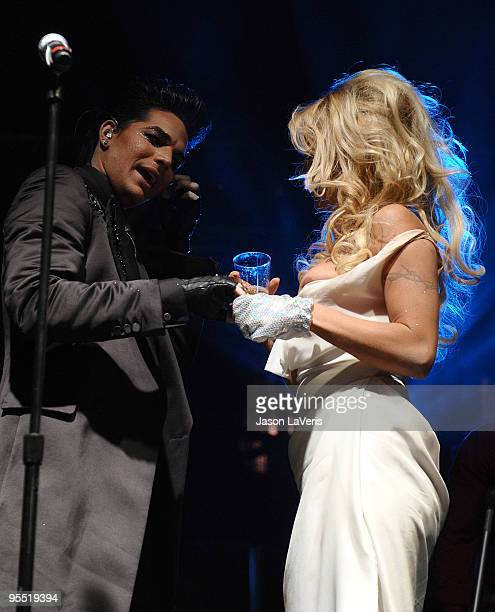 Adam Lambert and Pamela Anderson on stage at the Gridlock 2010 New Year's Eve bash at Paramount Studios on December 31 2009 in Hollywood California