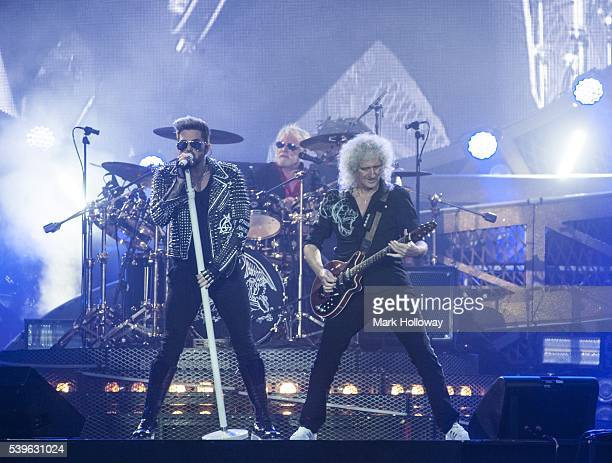Adam Lambert, Brian May and Roger Taylor of Queen + Adam Lambert perform on stage at Seaclose Park on June 12, 2016 in Newport, Isle of Wight.