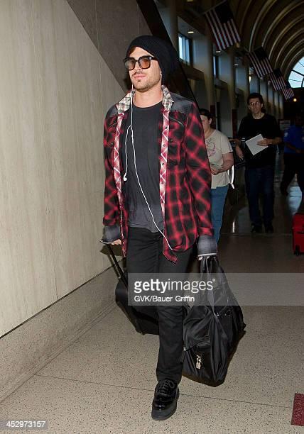 Adam Lambert is seen arriving at LAX airport on December 01 2013 in Los Angeles California