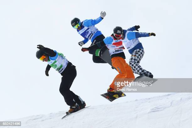 Adam Lambert of Australia Omar Visintin of Italy Lucas Eguibar of Spain and Nick Baumgartner of the United States compete in the Men's Snowboard...