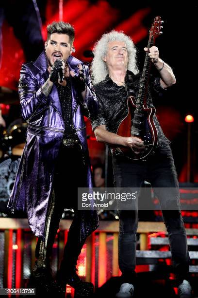 Adam Lambert performs alongside Brian May of Queen at ANZ Stadium on February 15, 2020 in Sydney, Australia.