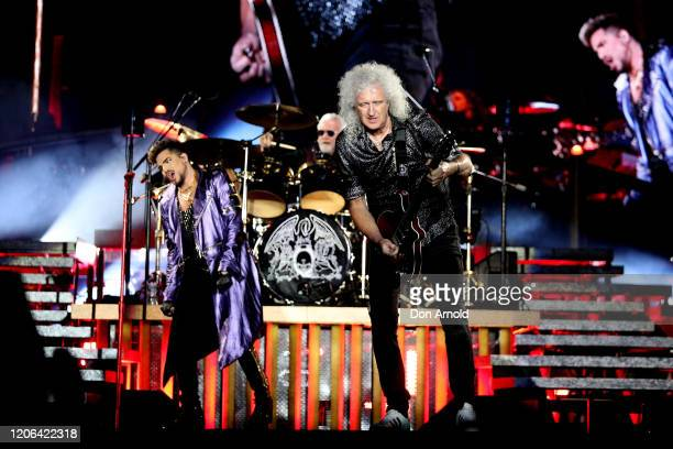 Adam Lambert performs alongside Roger Taylor and Brian May of Queen at ANZ Stadium on February 15 2020 in Sydney Australia