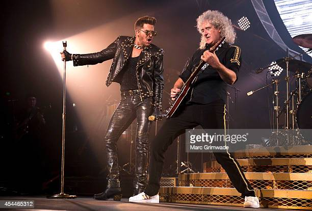 Adam Lambert performs live with Brian May of Queen at Brisbane Entertainment Centre on September 1, 2014 in Brisbane, Australia.