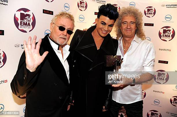 Adam Lambert poses backstage with Roger Taylor and Brian May of Queen with their Global Icon award during the MTV Europe Music Awards 2011 live show...