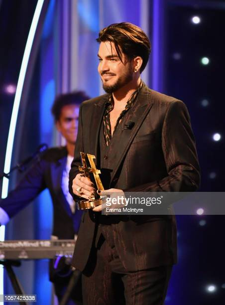 Adam Lambert presents an award onstage during the 22nd Annual Hollywood Film Awards at The Beverly Hilton Hotel on November 4 2018 in Beverly Hills...