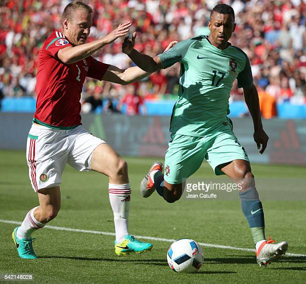 Adam Lang of Hungary and Nani of Portugal in action during the UEFA EURO 2016 Group F match between Hungary and Portugal at Stade des Lumieres on...