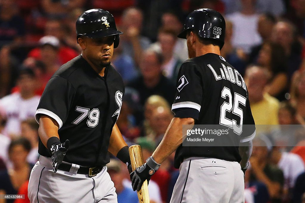 Adam LaRoche #25 of the Chicago White Sox congratulates Jose Abreu #79 after he hit a two run homer during the first inning against the Boston Red Sox at Fenway Park on July 30, 2015 in Boston, Massachusetts.
