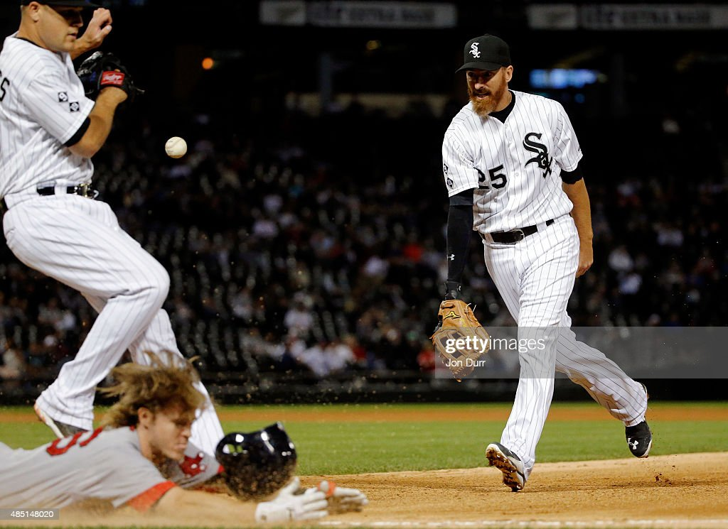 Adam LaRoche #25 of the Chicago White Sox tosses the ball to to Dan Jennings #43 as Brock Holt #26 of the Boston Red Sox dives safely into first base during the eighth inning at U.S. Cellular Field on August 24, 2015 in Chicago, Illinois.