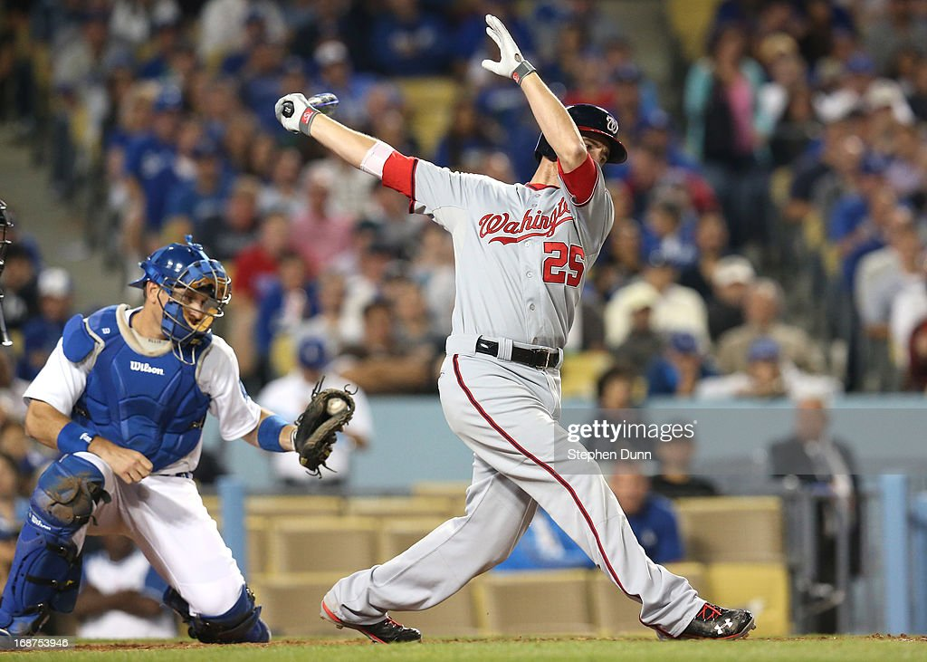 Adam LaRoche #25 of the Washington Nationals to end the top of the sixth inning as catcher A.J. Ellis #17 of the Los Angeles Dodgers holds onto the ball at Dodger Stadium on May 14, 2013 in Los Angeles, California.