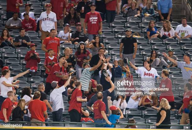 Adam LaRoche's tworun home run leaves the park in the top of the eighth inning Thursday at Angel Stadium INFO angels0821kjs Photo by KEVIN SULLIVAN /...