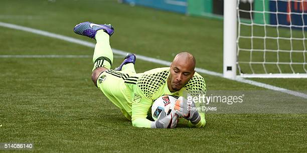 Adam Larsen Kwarasey of Portland Timbers dives on a ball during the second half of the game against the Columbus Crew at Providence Park on March 6...