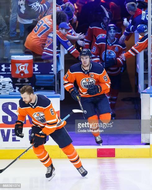 Adam Larsson and Connor McDavid of the Edmonton Oilers warm up against the Toronto Maple Leafs at Rogers Place on November 30 2017 in Edmonton Canada