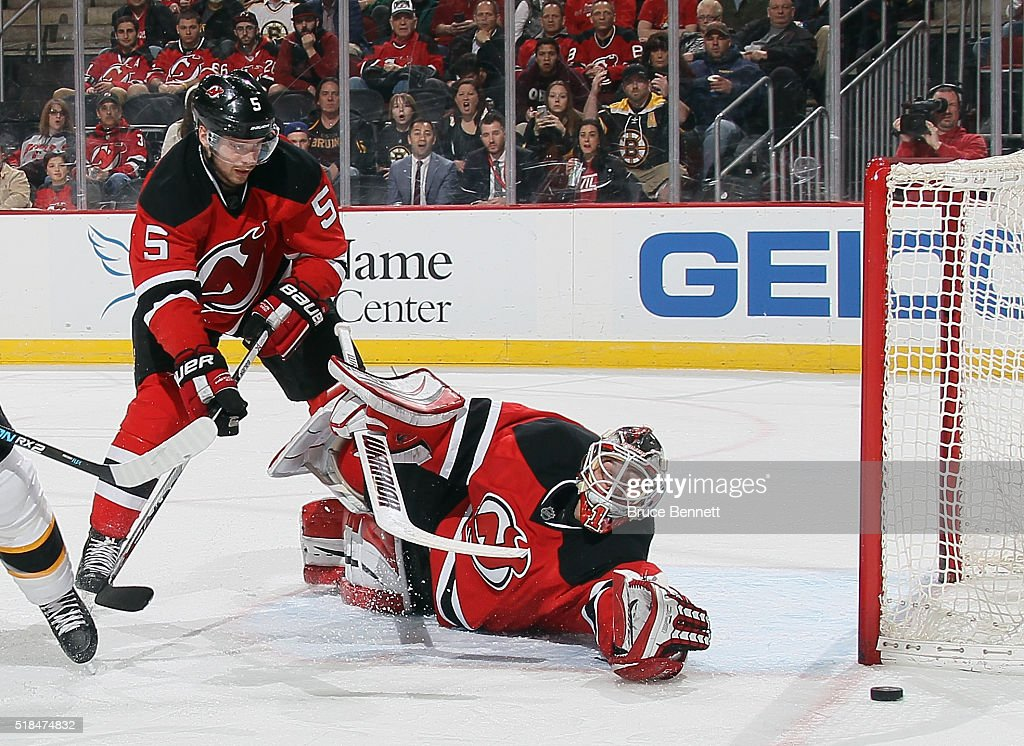 Adam Larsson #5 and Keith Kinkaid #1 of the New Jersey Devils defend against the Boston Bruins at the Prudential Center on March 29, 2016 in Newark, New Jersey.
