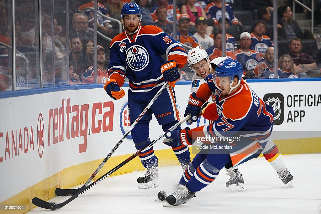 Adam Larsson #6 and Oscar Klefbom #77 of the Edmonton Oilers defend their zone against Garnet Hathaway #64 of the Calgary Flames in an NHL preseason game on September 26, 2016 at Rogers Place in Edmonton, Alberta, Canada.