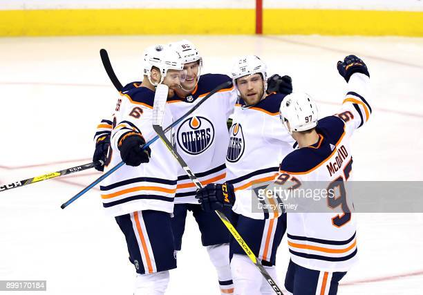 Adam Larsson Brandon Davidson Leon Draisaitl and Connor McDavid of the Edmonton Oilers celebrate a first period goal against the Winnipeg Jets at the...