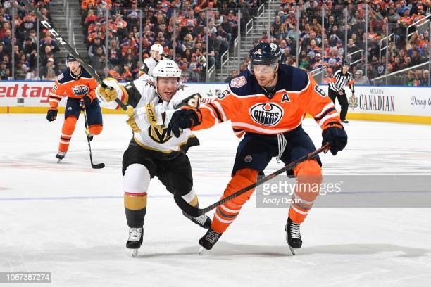 Adam Larsson of the Edmonton Oilers battles for the puck against Jonathan Marchessault of the Vegas Golden Knights on December 1 2018 at Rogers Place...