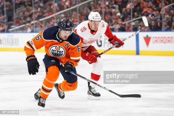 Adam Larsson of the Edmonton Oilers battles with Anthony Mantha of the Detroit Red Wings at Rogers Place on November 5 2017 in Edmonton Canada