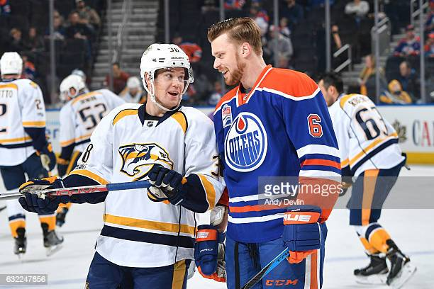 Adam Larsson of the Edmonton Oilers chats with Viktor Arvidsson of the game against the Nashville Predators on January 20 2017 at Rogers Place in...