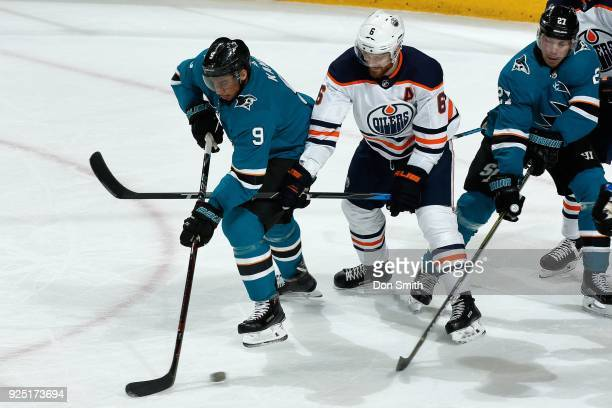Adam Larsson of the Edmonton Oilers defends Evander Kane of the San Jose Sharks at SAP Center on February 27 2018 in San Jose California