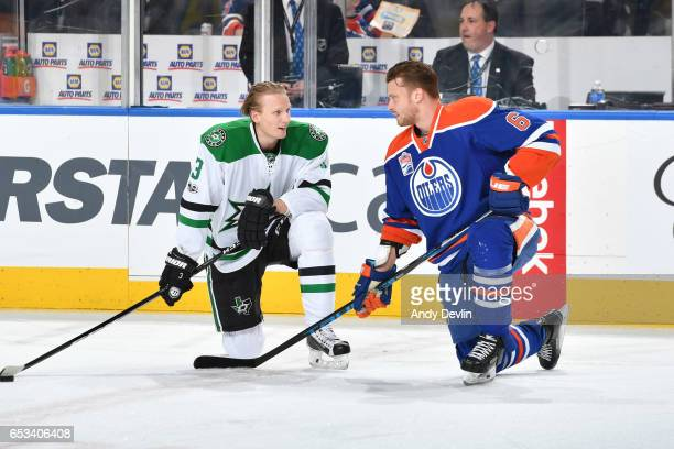 Adam Larsson of the Edmonton Oilers exchanges words with John Klingberg of the Dallas Stars on March 14 2017 at Rogers Place in Edmonton Alberta...