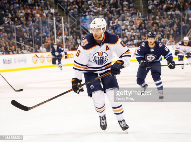 Adam Larsson of the Edmonton Oilers keeps an eye on the play during second period action against the Winnipeg Jets at the Bell MTS Place on December...