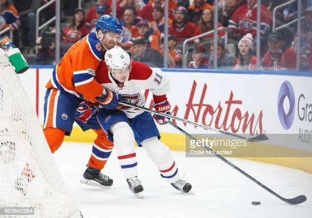 Adam Larsson of the Edmonton Oilers pursues Brendan Gallagher of the Montreal Canadiens on March 12 2017 at Rogers Place in Edmonton Alberta Canada