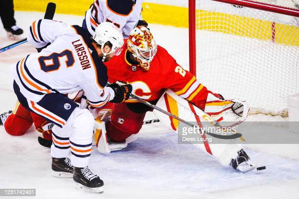 Adam Larsson of the Edmonton Oilers scores against goaltender Jacob Markstrom of the Calgary Flames during the second period an NHL game at...