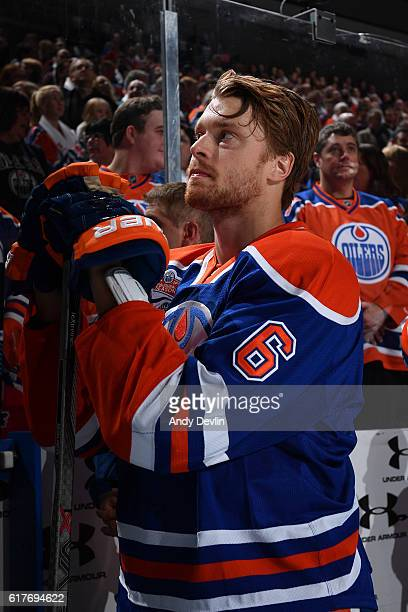Adam Larsson of the Edmonton Oilers stand for the singing of the national anthem prior to the game against the Buffalo Sabres on October 16 2016 at...