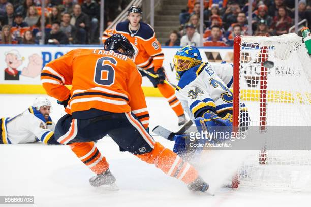 Adam Larsson of the Edmonton Oilers takes a shot on goaltender Jake Allen of the St Louis Blues at Rogers Place on December 21 2017 in Edmonton Canada