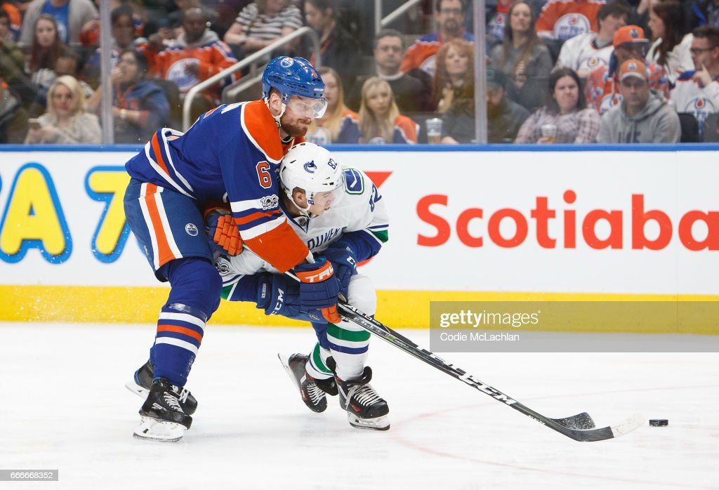 Adam Larsson #6 of the Edmonton Oilers ties up Nikolay Goldobin #82 of the Vancouver Canucks on April 9, 2017 at Rogers Place in Edmonton, Alberta, Canada. The Oilers won 5-2.