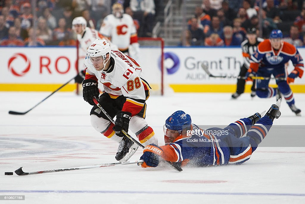 Adam Larsson #6 of the Edmonton Oilers tries to get in the way of Andrew Mangiapane #88 of the Calgary Flames in an NHL preseason game on September 26, 2016 at Rogers Place in Edmonton, Alberta, Canada.