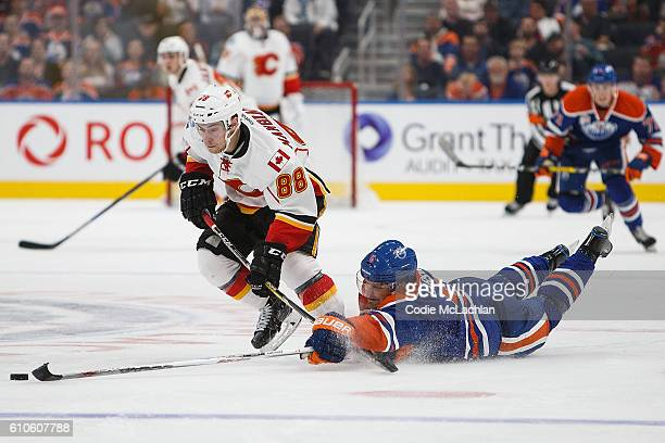 Adam Larsson of the Edmonton Oilers tries to get in the way of Andrew Mangiapane of the Calgary Flames in an NHL preseason game on September 26 2016...